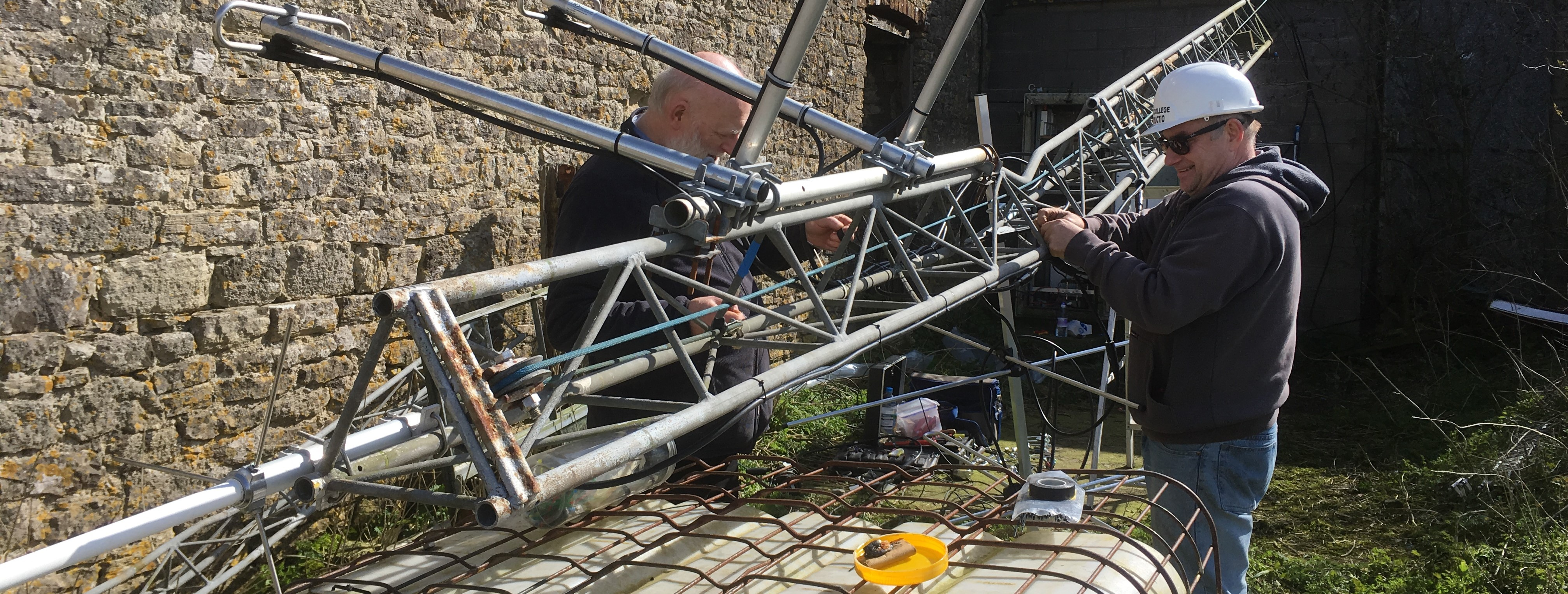 Photo - Installation of the transmitter - Andy and Rob attaching the new aerial to the mast