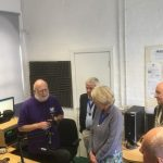 Photo of Andy Worth showing guests around the studios