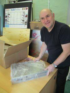 Rob Mott unpacking the new transmitter