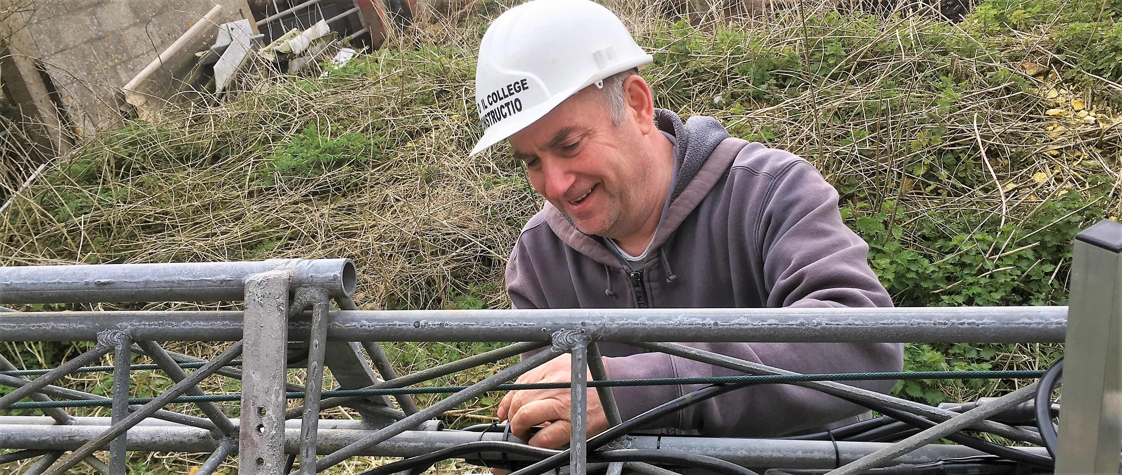 Photo - Rob cabling the new transmitter aerial