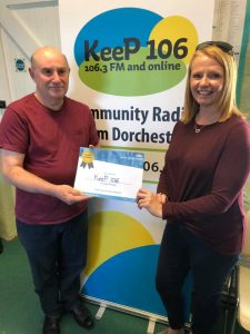 Photo of Rob Mott receiving certificate from Jo Thompson