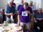 David Taylor cuts the second cake