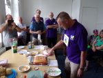 David Taylor cuts the first cake!