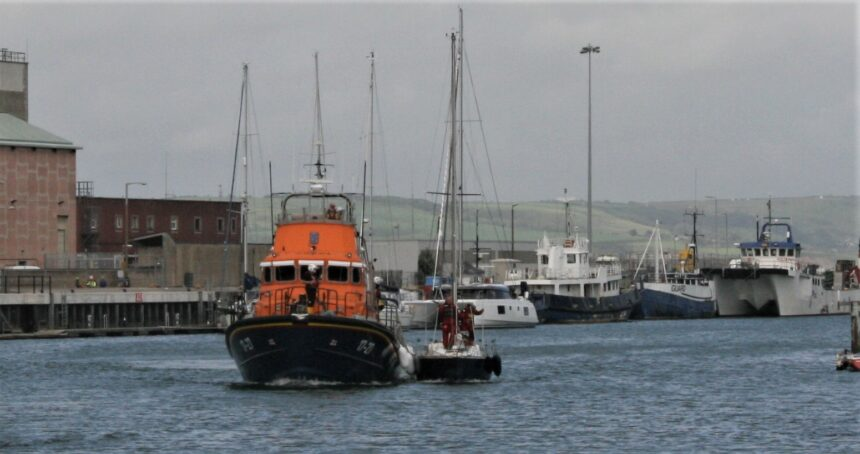 All Weather Lifeboat with yacht in tow