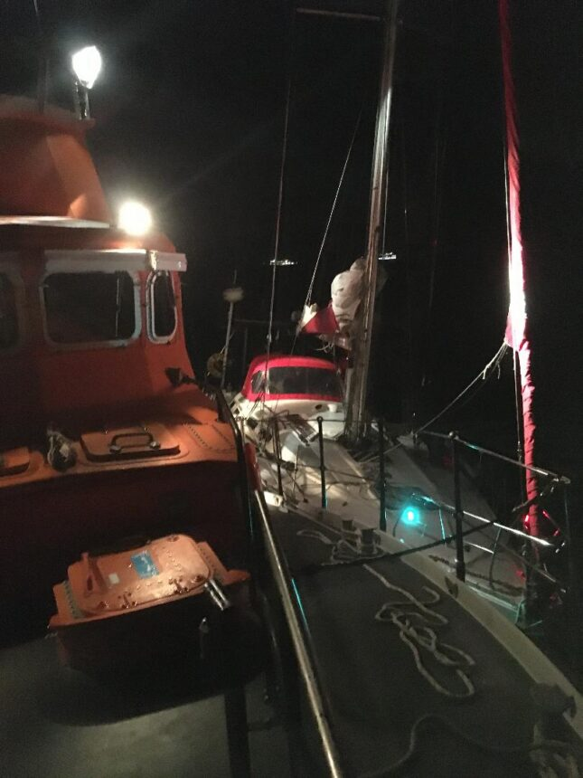 Lifeboat alongside rescued yacht