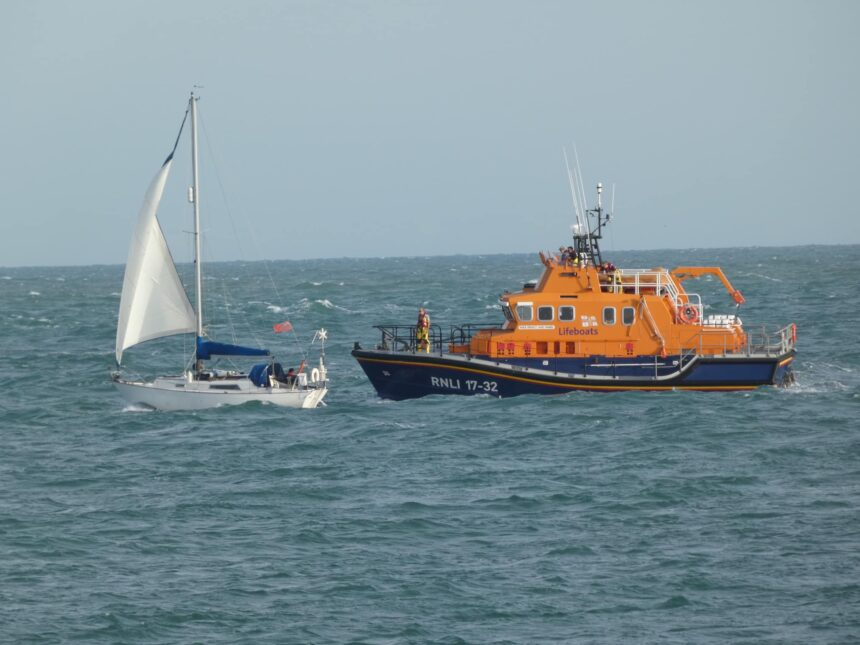 All weather lifeboat escorting yacht
